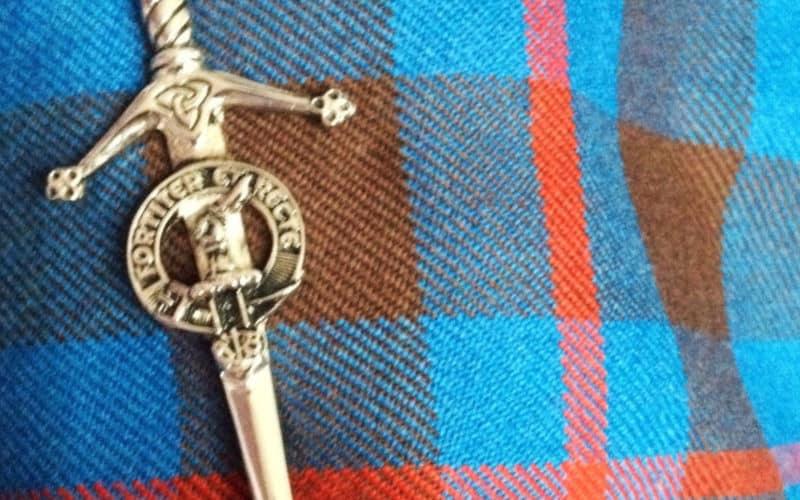 tartan of a kilt with a kilt pin
