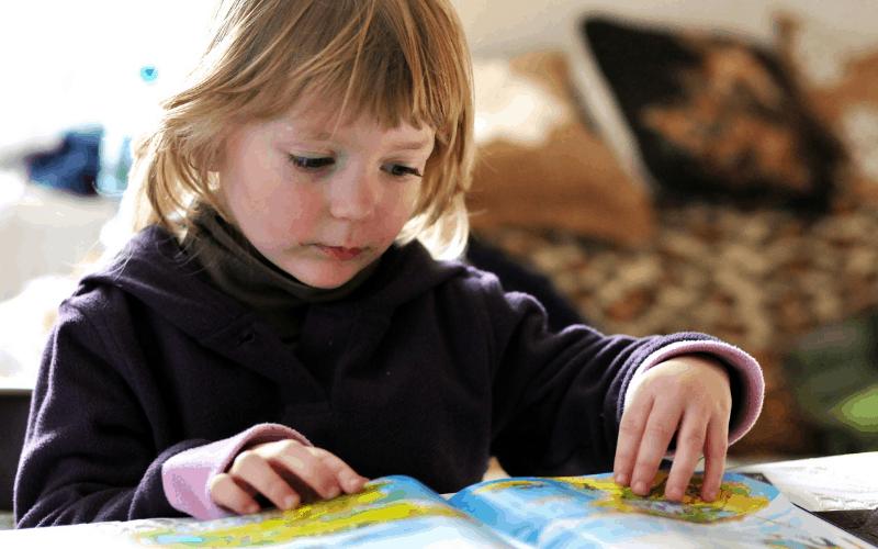 Girl reads children's books for hard topics.