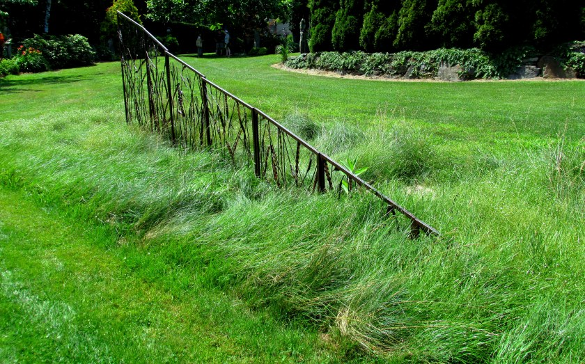 Not strictly in the GrassAcre area, but I love this swath of grasses with a fence-like sculpture