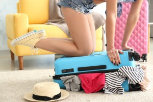 A girl packing her luggage for an upcoming trip