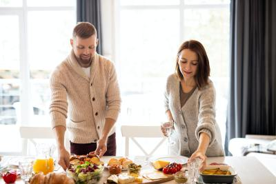 A couple cooking dinner together in their home