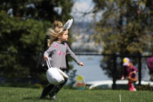 child running with easter basket in egg hunt
