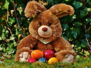 stuffed bunny with colourful easter eggs