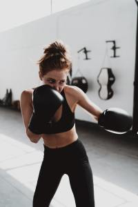 Women wearing sports bra and boxing gloves