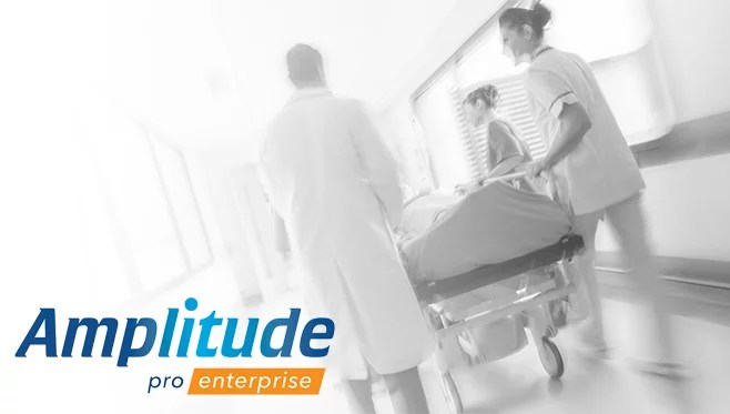 pro 1 logo – black and white hospital corridor with dr nurse and bed