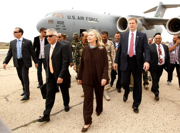 US Secretary of State Hillary Clinton walks from her C-17 military transport upon her arrival in Tripoli in Libya, October 18, 2011.  (KEVIN LAMARQUE/AFP/Getty Images)