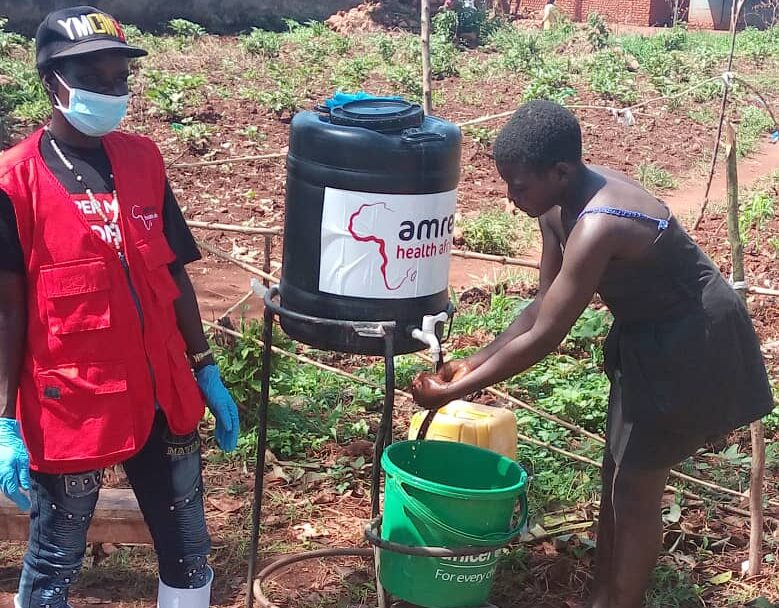 A young girl washing her hands before entering the market place
