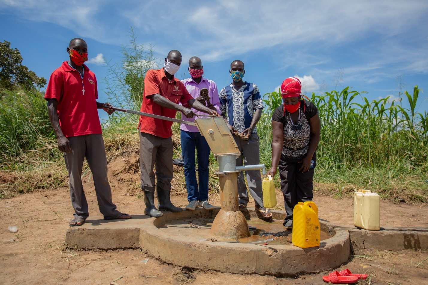 A group of bore hole maintance group in Amuru renovating a bore hole.