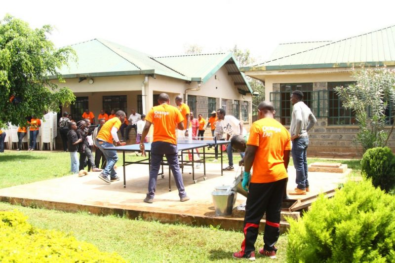 GSK team playing table tennis with the children from Amref Child Protection and Development Centre Dagoretti