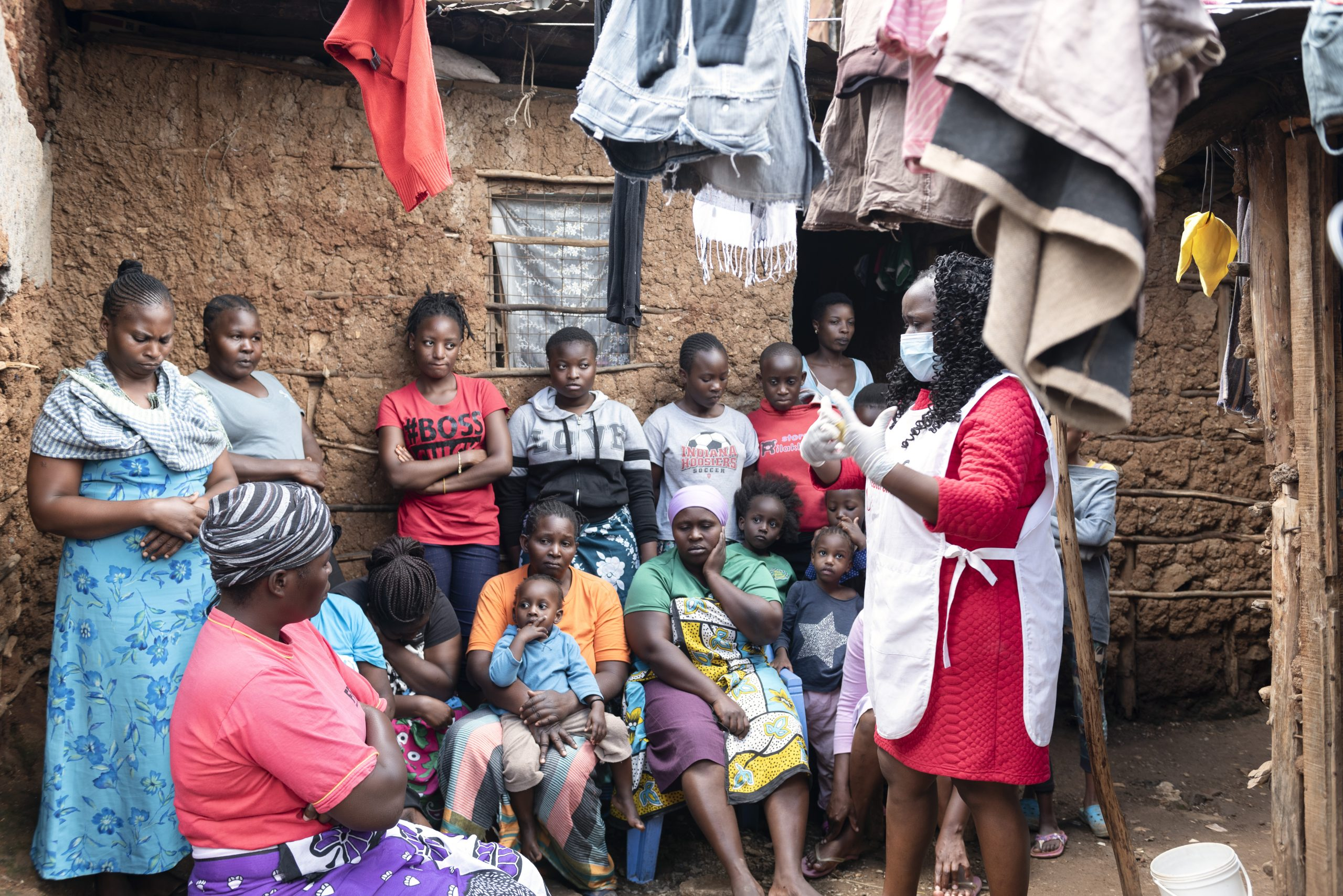 Margaret Kilonzo eduactes a household in Kibera on how they can prevent themseves from coronavirus