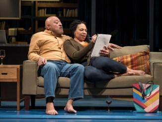 A man and woman on a couch
