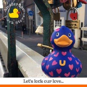Sweethearts making it official with love locks @ Groenburgwal bridge, Amsterdam