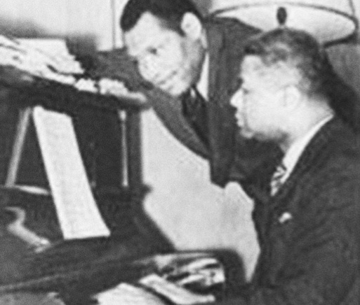 Lawrence Brown at the piano with Paul Robeson looking on (81170)