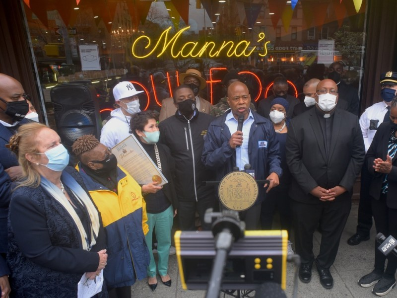 Manna's Restaurant owner Betty Park receives a proclamation from city officals (303762)