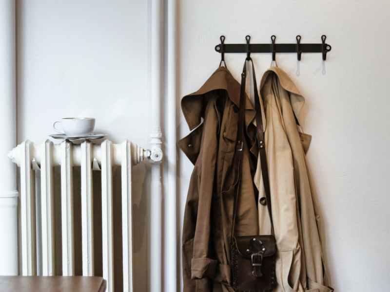 coats and shoulder bag on hooks in house