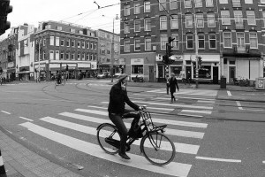 Dutchman using smartphone on a bike in Amsterdam while ignoring the lights