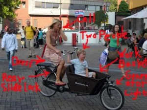 using a smartphone while cycling with kids in a bakfiets