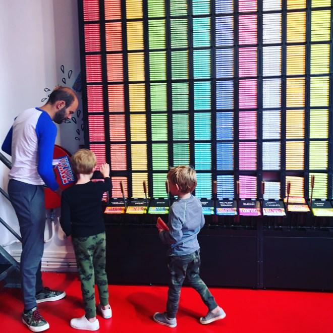 Amsterdam with kids - children enjoying the chocolate vending machine at Tony's Chocolonely