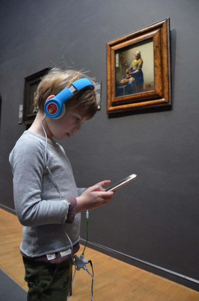 Boy enjoying the Rijksmuseum app