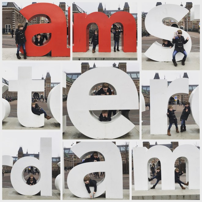 Children playing at the I Amsterdam letters in the Museumplein in front of the Rijksmuseum in Amsterdam