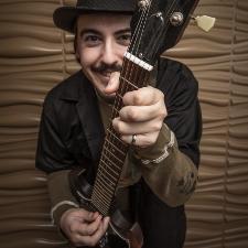 Tyler Gilbert with guitar