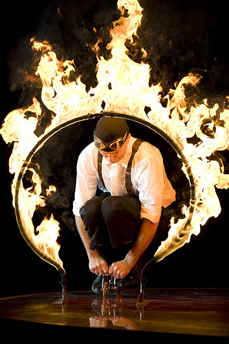 Justin Case Bicycles through a Ring of Fire in Ringling Bros. Coney Island Boom A Ring Circus. Photo by rbbbconeyisland via flickr