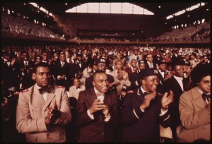 A crowd of African Muslims applaud during Elijah Muhammad's annual Saviors' Day message in Chicago in 1974. Source: wikipedia  Indigenous Muslims: The Descendants of Slaves and Early Immigrants (2) 800px A PORTION OF A CROWD OF SOME 10000 MUSLIMS APPLAUD ELIJAH MUHAMMAD DURING THE DELIVERY OF HIS ANNUAL SAVIORS DAY