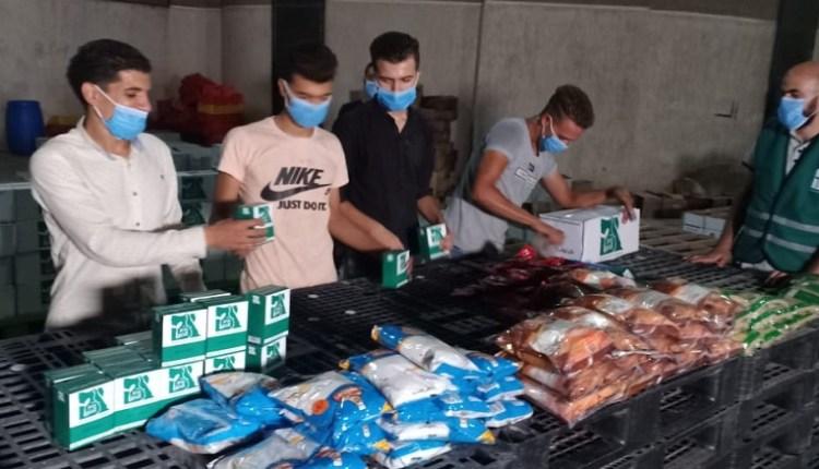 جانب من عملية تعبيئة المساعدات لضحايا انفجار بيروت