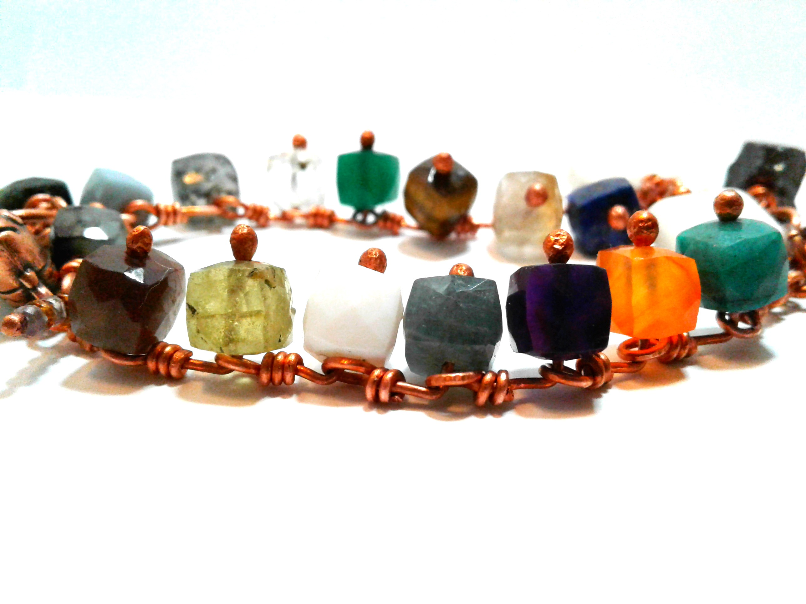 circle of multi-colored gemstone cube beads on copper links