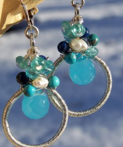 silver circle earrings with beads in shades of blue at the top