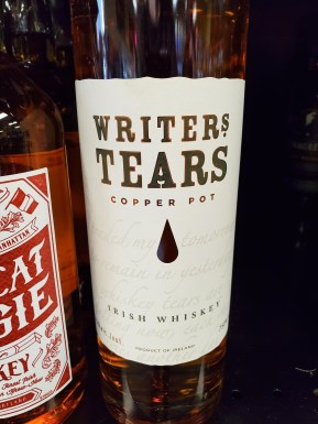 A bottle of Irish Whiskey labeled Writer's Tears.