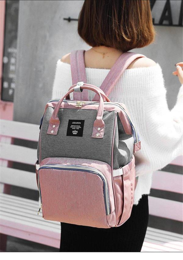 Pink and Grey Diaper Backpack on Shoulder