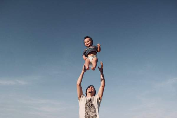 Happy kid with father
