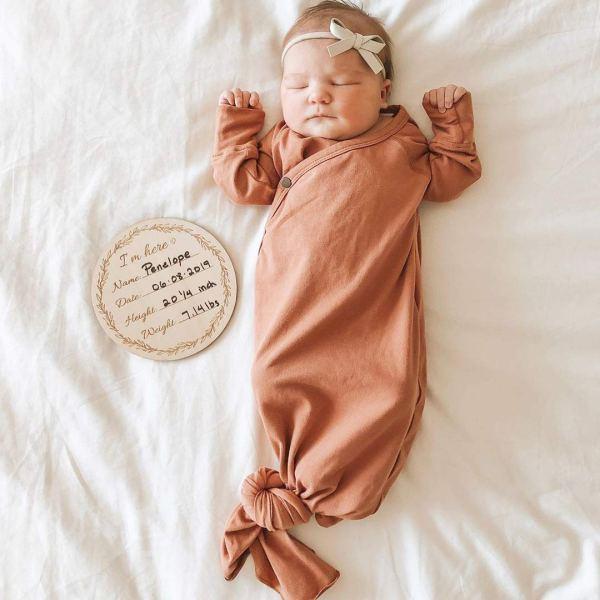 Baby Sleeping Next to Birth Card