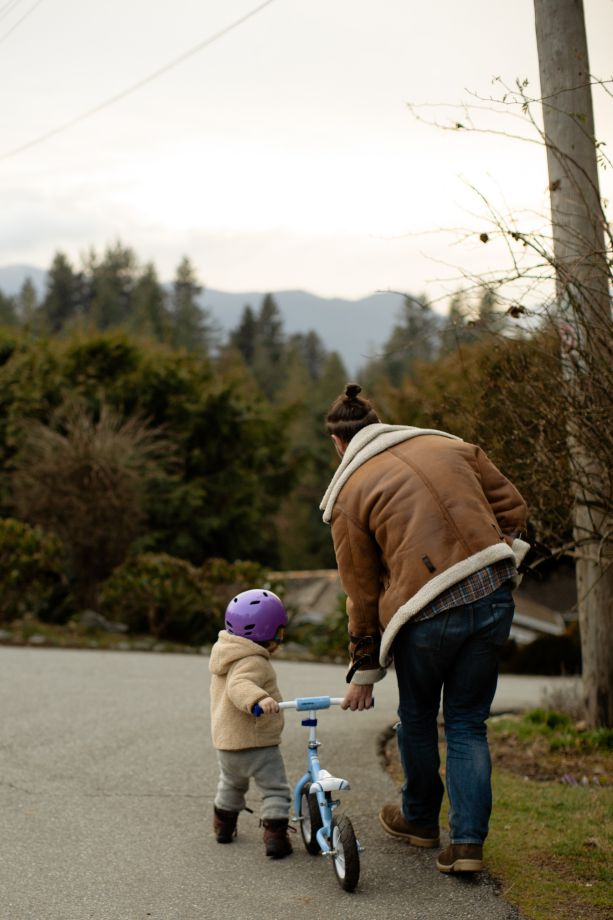 Dad Helping Child for First Bike Ride