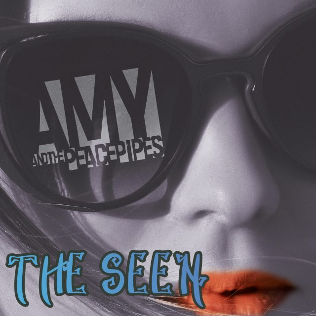 """The Seen Single Cover - Woman with sunglasses with the """"Amy and the Peace Pipes"""" logo imposed on one of the lenses."""