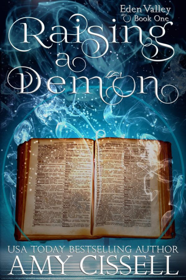 Book cover for Raising a Demon - blue background with blue smoke rising out of a magical looking book. Text: Raising a Demon. Eden Valley Book One. USA Today Bestselling Author Amy Cissell