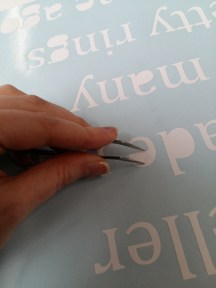 You have to peel off the excess vinyl with special tools, making sure not to damage the surrounding area.