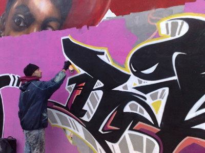 Rarebit (real name Craig Jones) from Port Talbot works on a piece at a legal wall site in Roath