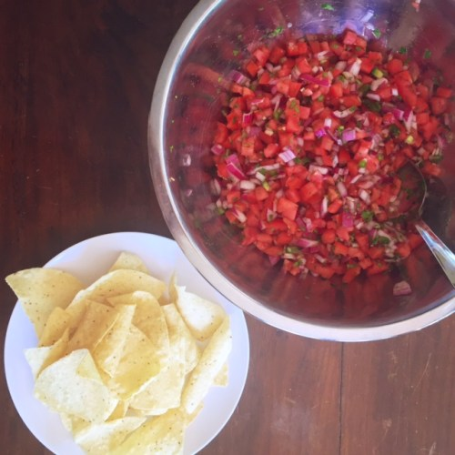 big silver bowl of salsa and chips