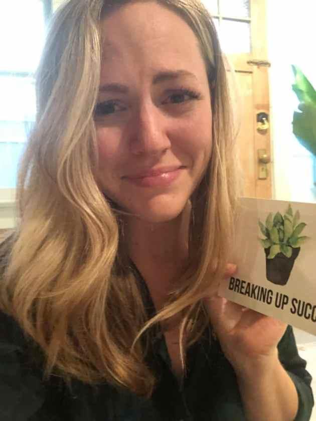 girl holding break up card