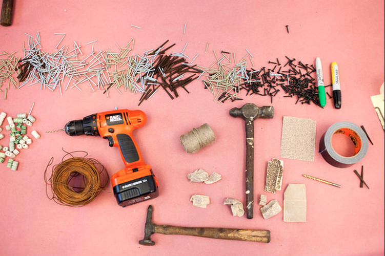 Hammers, drills, nails and sandpaper were artfully laid out for use. Credit: Robert Wright for The New York Times