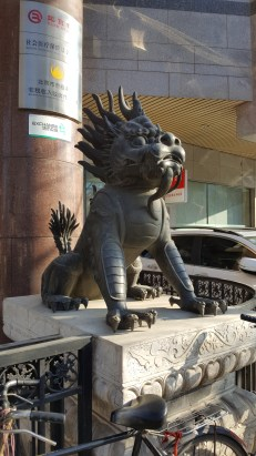 There are dragon and lion sculptures everywhere.