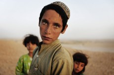 Afghan children, near the town of Kunjak in southern Afghanistan's Helmand province, on October 24, 2010. (Reuters/Finbarr O'Reilly)