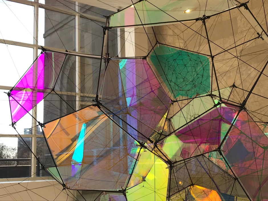 "modern stained glass in front of window Tomás Saraceno ""Entangled Orbits"