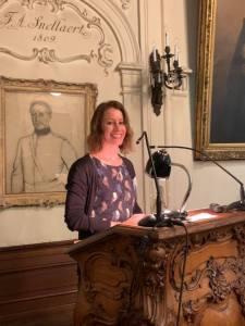 woman at microphone podium