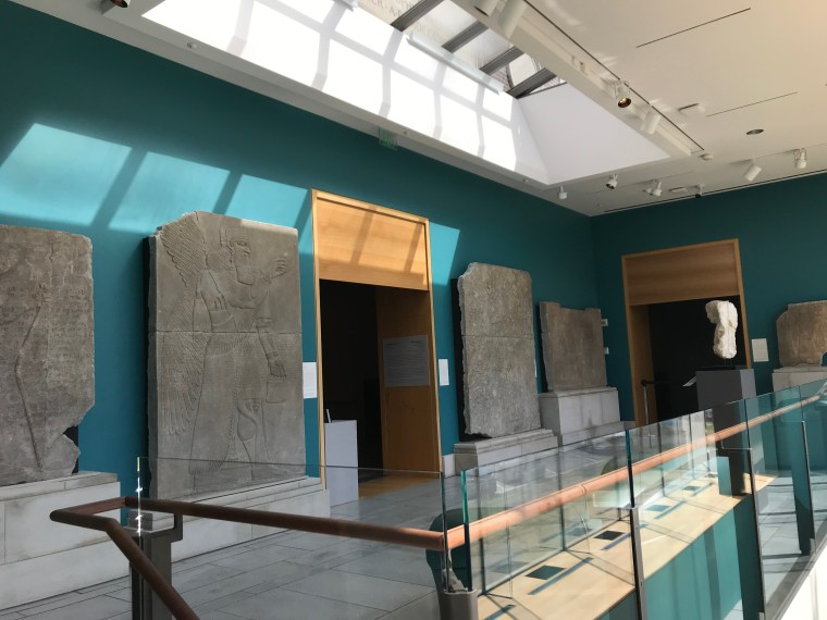 art museum gallery with stone pictures on walls
