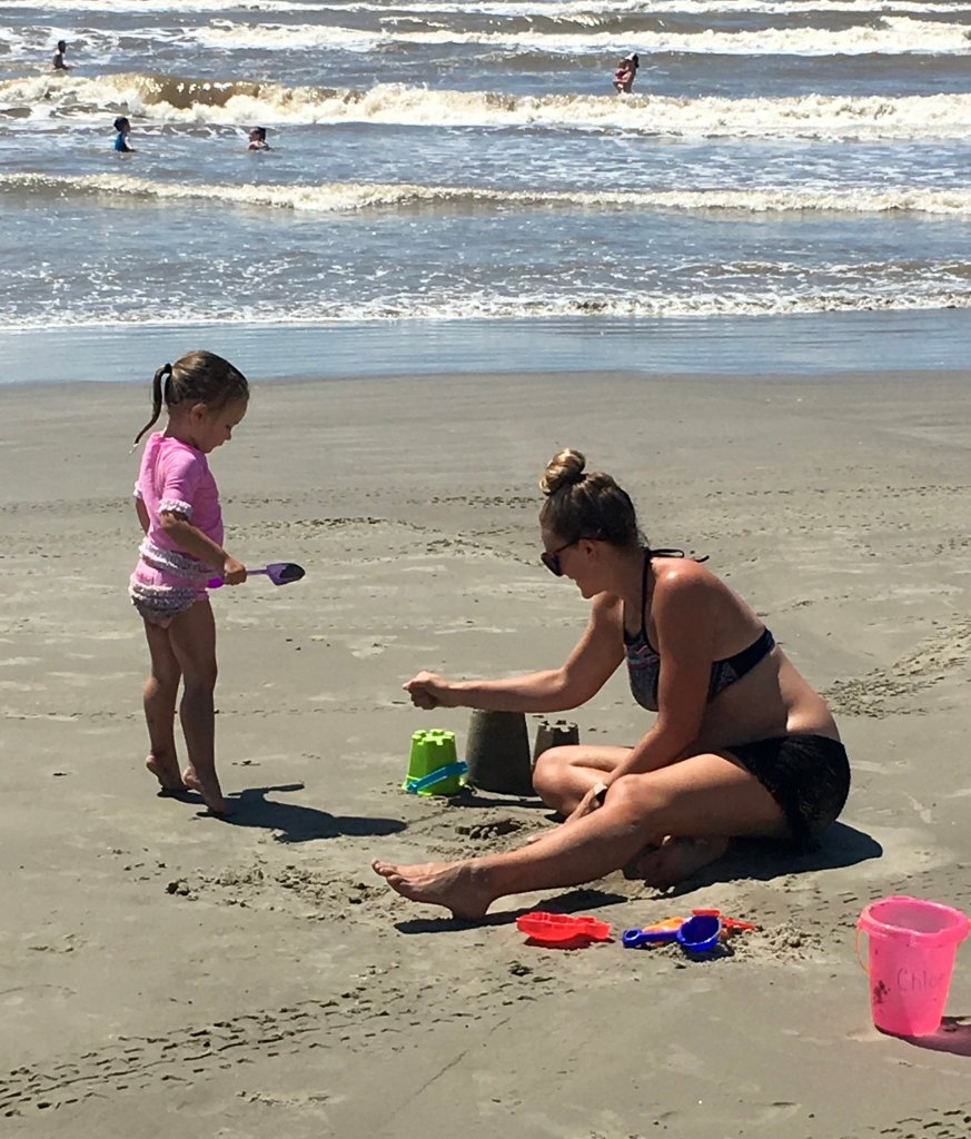Building sandcastles with toddler at the beach