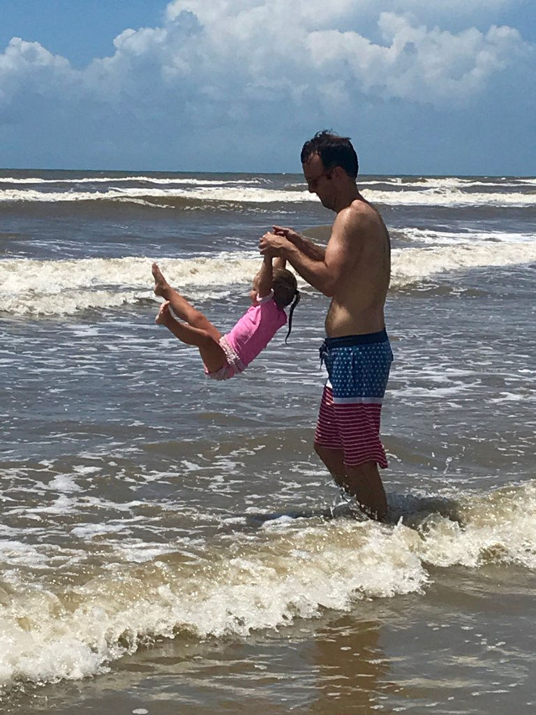 Jumping waves with toddler at the beach