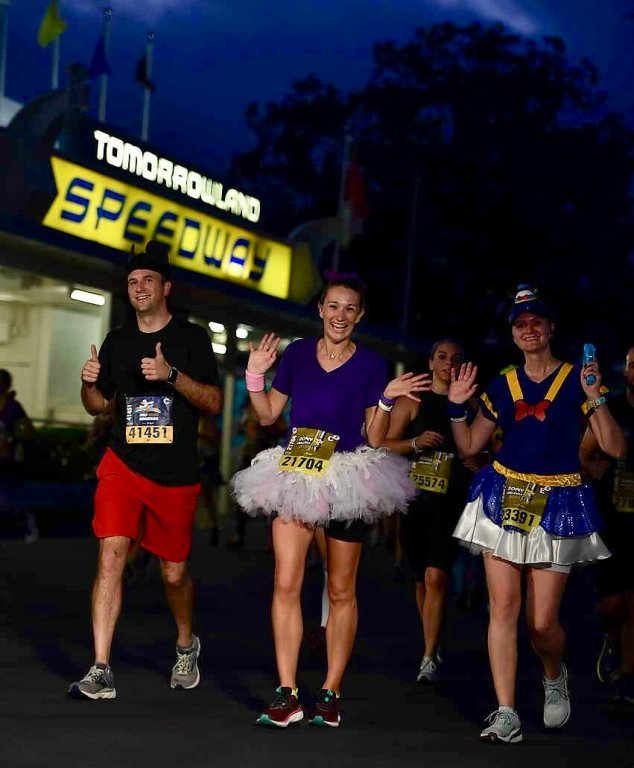 Running the Disney World Half Marathon! This is near mile 6 in Tomorrowland Magic Kingdom.  Costumes: Mickey, Daisy and Donald. Donald skirt by Dottie for Running. Rest of our costume are handmade or purchased from Amazon!
